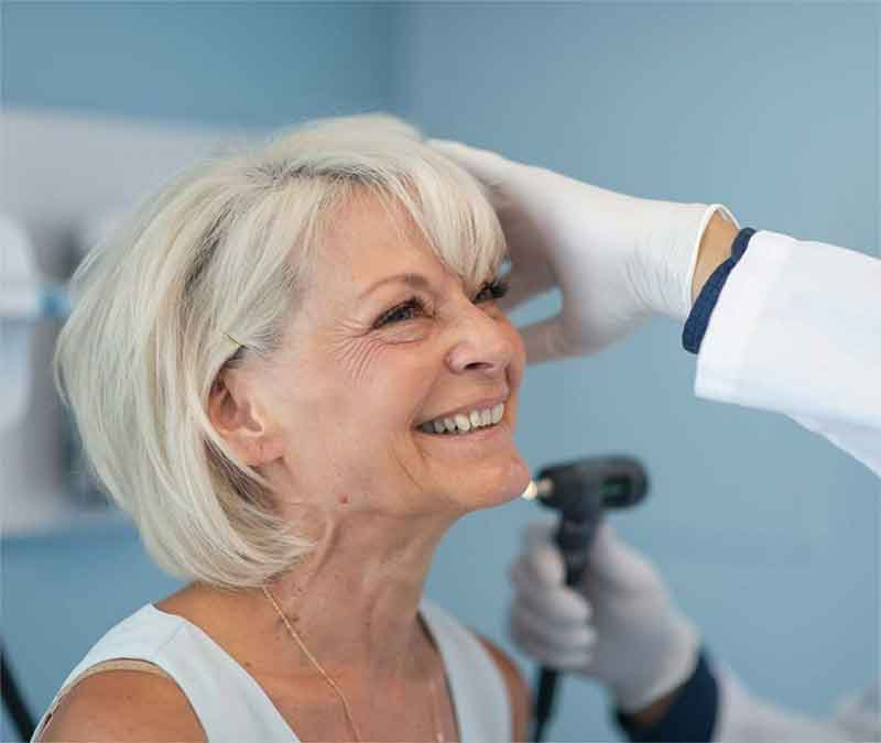 Woman getting ear examined